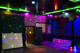 Lights shine at a no longer operative Karaoke hall in Kabul on Tuesday.