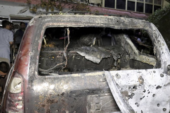 A destroyed vehicle at a house after a US drone strike in Kabul on Sunday.