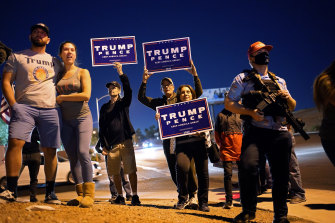 Supporters of President Donald Trump protest the Nevada vote in front of the Clark County Election Department in Las Vegas.