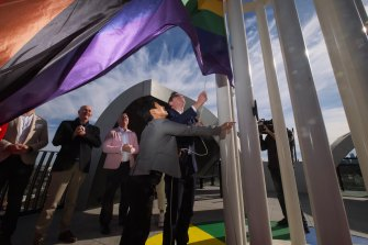 Premier Daniel Andrews and Victorian Pride Centre chair Hang Vo raise the flag at the centre in St Kilda on Sunday.