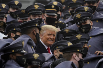 US President Donald Trump, who has refused to accept the election result, is surrounded by Army cadets as he watches the 121st Army-Navy Football Game at the United States Military Academy in West Point, New York.