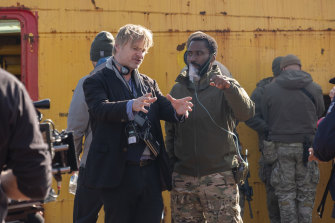 Nolan directs John David Washington on the set of Tenet.