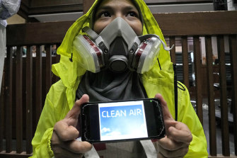 An activist wearing a face mask to represent those affected by air pollution during a protest before the judges announced their decision.