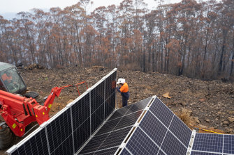 Workers install a solar and storage unit in bushfire hit Peak Alone, near the NSW town of Cobargo, provided by the Resilient Energy Collective.
