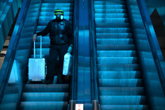 A lone passenger rides on an escalator beneath a coloured skylight at the Beijing Railway Station, which was largely quiet on the first day of the travel rush followingefforts to dissuade migrants from travelling to curb the spread of COVID-19.