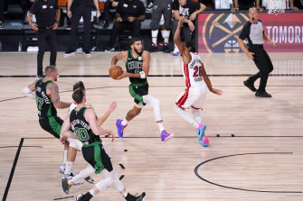 Boston's Jayson Tatum drives against Miami Heat's Andre Iguodala in their eastern conference final play-off clash.