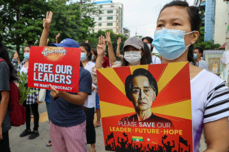 Anti-coup protesters march along a street in Yangon, Myanmar.