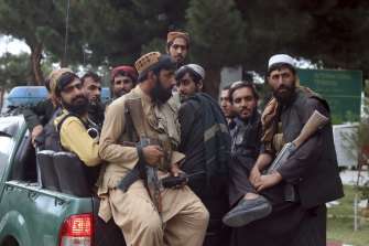 Taliban fighters arrive inside the Hamid Karzai International Airport after the U.S. military's withdrawal from Kabul.