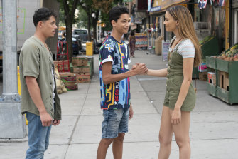 """Anthony Ramos, from left, Gregory Diaz and Leslie Grace in a scene from """"In the Heights""""."""