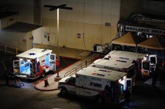 Ambulances outside the emergency room entrance at Loma Linda University Medical Center in Loma Linda, California.