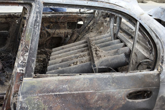 Rocket launcher tubes are seen inside a destroyed vehicle in Kabul, Afghanistan, on Monday, August 30.