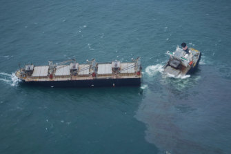A large oil slick could be seen in waters surrounding the ship.