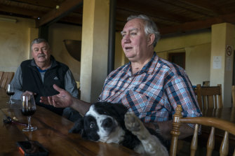 Wine farmer Stefan Smit drinks with friends at his Louiesenhof Wines farm which is next to the Kayamandi township outside Stellenbosch, South Africa, in 2018.