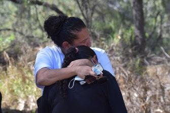 Lesley Fernando comforts Narelle Copeland.