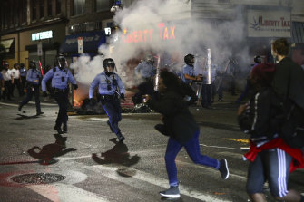 Police face off with protesters along 52nd Street in West Philadelphia in the early hours of Tuesday.