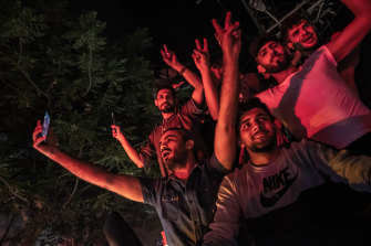 Palestinians celebrate the ceasefire agreement between Israel and Hamas on May 21, 2021 in Gaza City, Gaza.