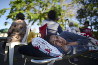 Maribel Rivera Silva, 58, rests outside a shelter after an earthquake in Guanica, Puerto Rico.