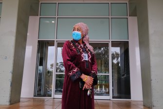 Ruth Eyakem, a resident of one of the  Flemington social housing towers, outside her building on Saturday.