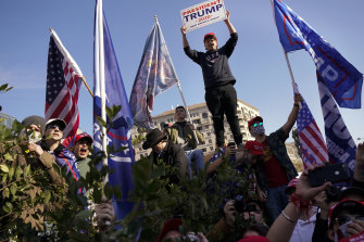 Supporters of President Donald Trump attend a pro-Trump march on Saturday, November 14 in Washington.