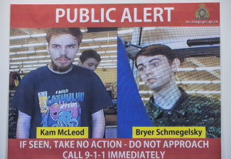Security camera images of Kam McLeod, 19, and Bryer Schmegelsky, 18, are displayed during a news conference in suburban Vancouver. They're being sought in the murder of the Australian and American backpacker couple.