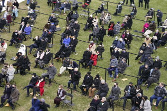 The surging coronavirus pandemic and the threat of violence kept the audience at the inauguration small and socially distanced.