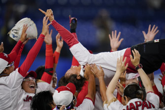Japan's softball team celebrates its gold medal win over USA.