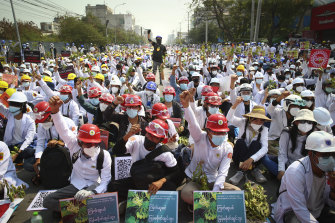 Protesters shout slogans during a protest against the military coup in Mandalay, Myanmar.