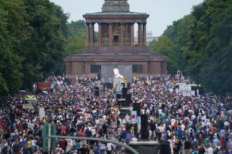 Protesters gather at the Victory Column in the Berlin to hear speeches during a protest against coronavirus-related restrictions.