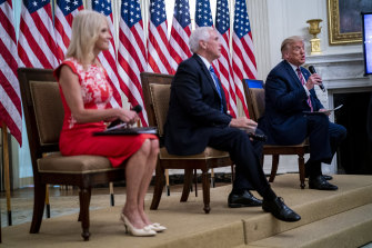 President Donald Trump, right, speaks while Kellyanne Conway, left, and Vice-President Mike Pence listen during an event on reopening schools earlier this month.