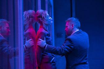 Elizabeth Debicki and Kenneth Branagh in the spy thriller Tenet.