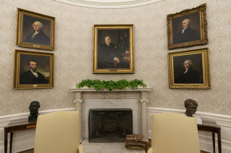 The artworks include a pairing of former President Franklin D. Roosevelt over the mantle of the fireplace.