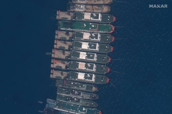 A satellite image shows Chinese vessels anchored at Whitsun Reef, located in the disputed South China Sea.