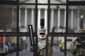 Members of the National Guard stand inside the security fencing at the Capitol ahead of the inauguration of President-elect Joe Biden and Vice President-elect Kamala Harris.
