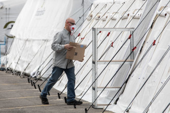 A man handles a box at a Samaritan's Purse Emergency Field Hospital in Cremona, near Milan, Italy.