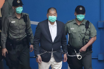 Jimmy Lai, centre, pictured in custody earlier this month.