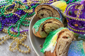 Associated with epiphany in many countries, a King Cake features purple icing for justice, green for faith and gold for power.