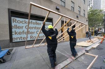 Workers erect barricades around the Rockefeller Centre in Manhattan.