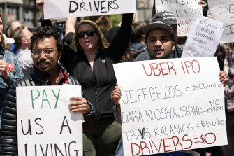 People protest low wages outside Uber's headquarters in San Francisco in 2019.