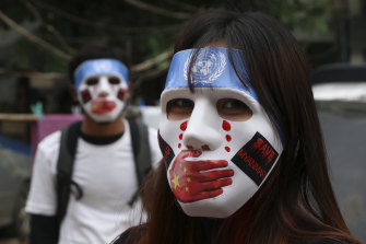 Young demonstrators participate in an anti-coup mask strike in Yangon, Myanmar.