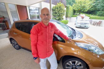 """AGL's Markus Brokhof with his second-hand EV. """"I can charge it at home with a normal socket and it's fun to drive because the acceleration is rapid."""""""