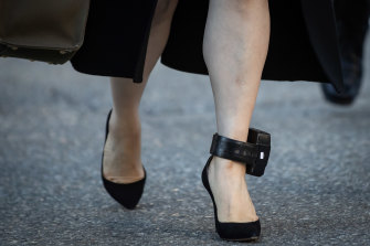 Meng Wanzhou, chief financial officer of Huawei Technologies, wears a GPS ankle monitor as she returns to Supreme Court.
