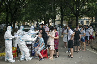 Residents line up to be tested for COVID-19 in Wuhan, China, this month.