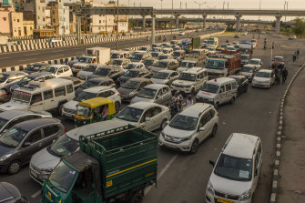 Vehicles driving on a road, after the country relaxed its lockdown restriction in Delhi, India.