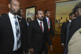 Ethiopia's Prime Minister Abiy Ahmed (centre) arrives at the African Union Summit in Addis Ababa in February.