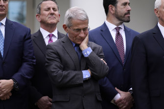 Dr Anthony Fauci, centre, has predicted up to 200,000 people could die in the US.