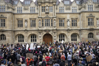 Protesters gather outside Oxford University's Oriel College, demanding the removal of a Cecil Rhodes statue from its facade.