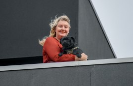 Soldiering on: Nicola Clement with Vernon on her apartment balcony.