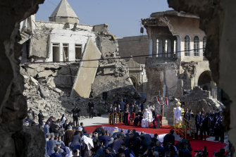 Pope Francis leads a prayer for the victims of war at Hosh al-Bieaa Church Square in Mosul on Sunday.