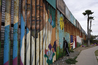 A man looks through the first wall at Friendship Park, near where the border separating Tijuana, Mexico, and San Diego meets the Pacific Ocean in Tijuana.