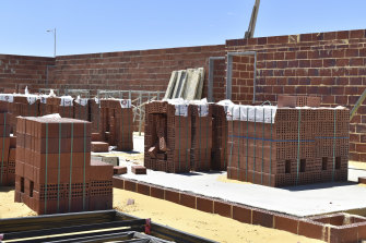 Dual building stimulus grants have meant thousands of homes in WA are at a similar stage of construction, pushing brickwork costs to nearly double.